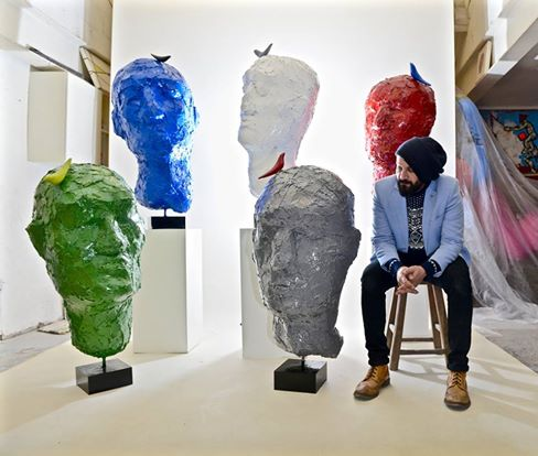 heads-and-sculptor